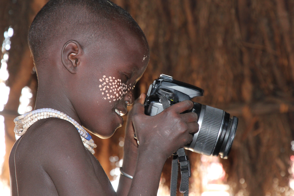 Kara girl with a digital camera